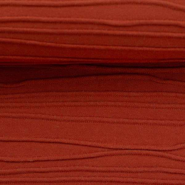 structuur tricot oranje rood